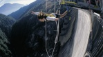 "Your holiday. Switzerland. Bungy jumping in the Ticino. The James Bond ""Golden Eye"" leap from the concrete dam at Verzasca sets a world record as the highest jump from the ground (220 m). Endlich Ferien. Ihre Schweiz. Bungy-Jumping im Tessin. James Bond-Sprung 'Golden Eye' von der Verzasca-Staumauer, weltweit höchster Sprung ab Boden (220 m). Enfin les vacances. A vous la Suisse. Bungy jumping au Tessin. Le saut James Bond &quotGolden Eye&quot au barrage de la Verzasca est le plus ÈlevÈ du monde depuis la terre ferme (220 m). Copyright by Switzerland Tourism By-line: ST/swiss-image.ch"