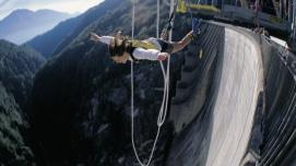 "Your holiday. Switzerland. Bungy jumping in the Ticino. The James Bond ""Golden Eye"" leap from the concrete dam at Verzasca sets a world record as the highest jump from the ground (220 m). Endlich Ferien. Ihre Schweiz. Bungy-Jumping im Tessin. James Bond-Sprung 'Golden Eye' von der Verzasca-Staumauer, weltweit höchster Sprung ab Boden (220 m). Enfin les vacances. A vous la Suisse. Bungy jumping au Tessin. Le saut James Bond &quotGolden Eye&quot au barrage de la Verzasca est le plus ÈlevÈ du monde depuis la terre ferme (220 m). Copyright by Switzerland Tourism By-line: ST/swiss-image.ch"